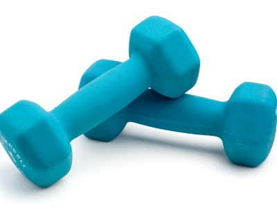 Two dumbell weights isolated on white with soft shadow.